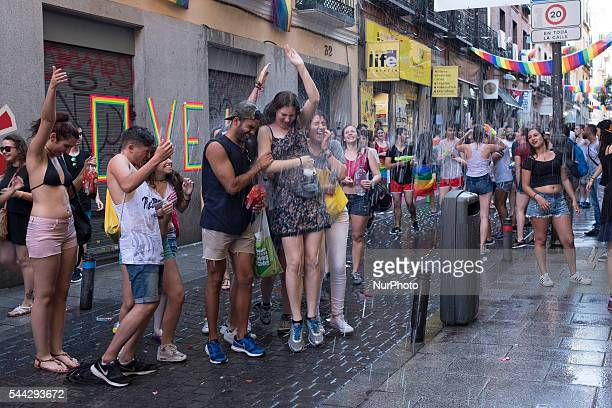 People water is poured during Water battle as part of the 2016 Madrid Gay Pride week on Jule 1 2016 in Madrid Spain Hundreds of thousands of...