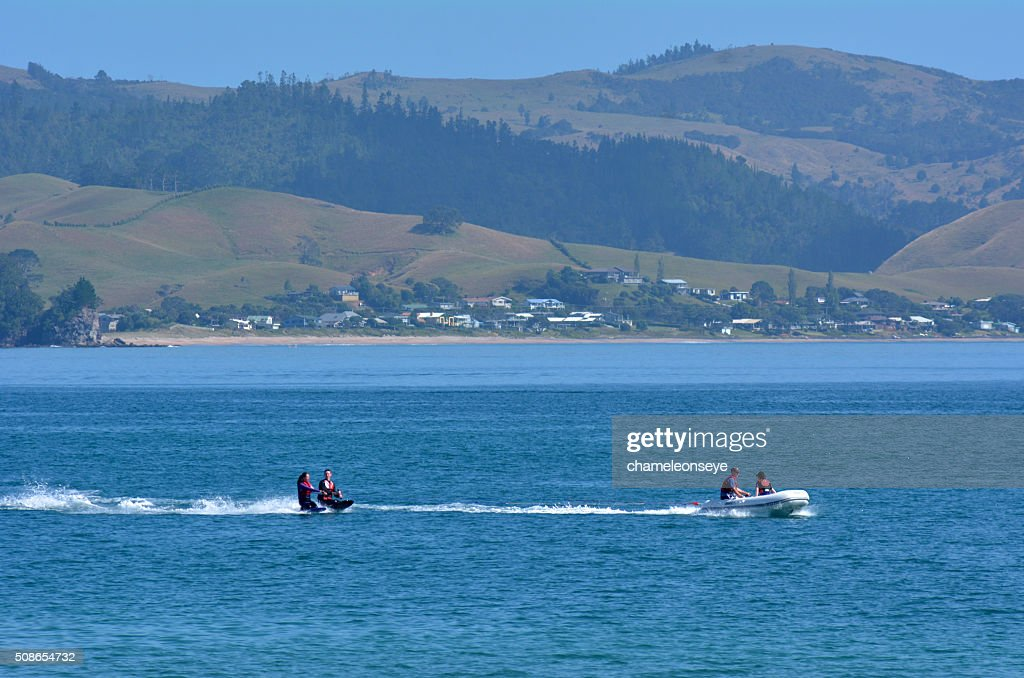 People water skiing over Mercury Bay New Zealand : Stock Photo