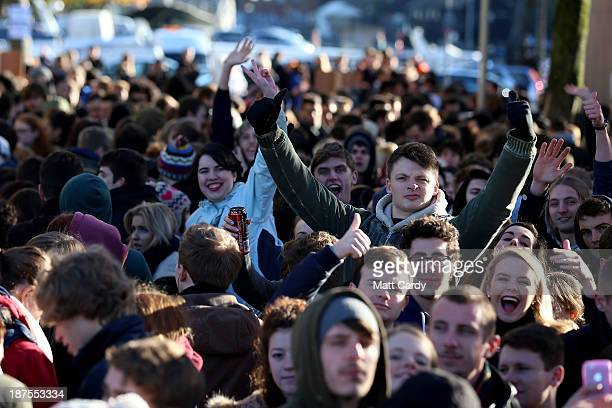 People wave and cheer as they queue outside the Bristol Arnolfini art centre for the second day of open auditions for two lead roles in the next Star...