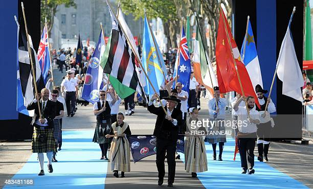 People wave Celtic flags on August 9 2015 in Lorient western France as part of the parade of Celtic countries during the 45th InterCeltic festival...