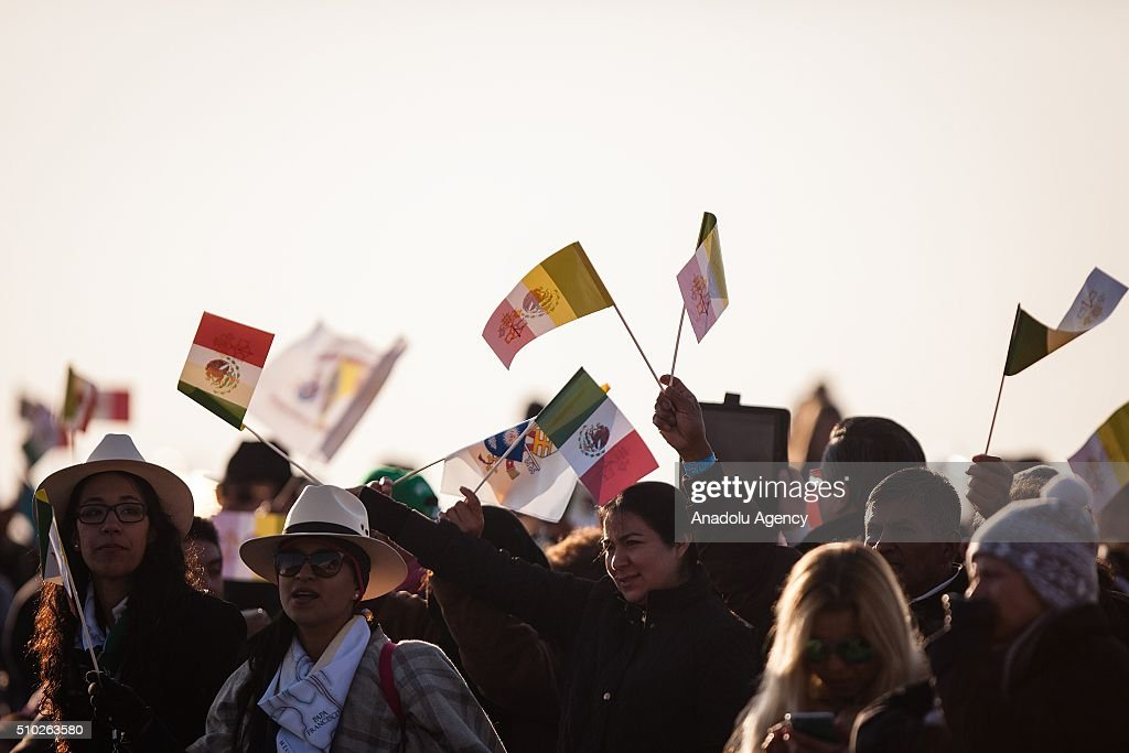 People wave flags before the mass of Pope Francis in Ecatepec in his Pastoral Visit to Mexico in Ecatepec, Mexico on February 14, 2016.