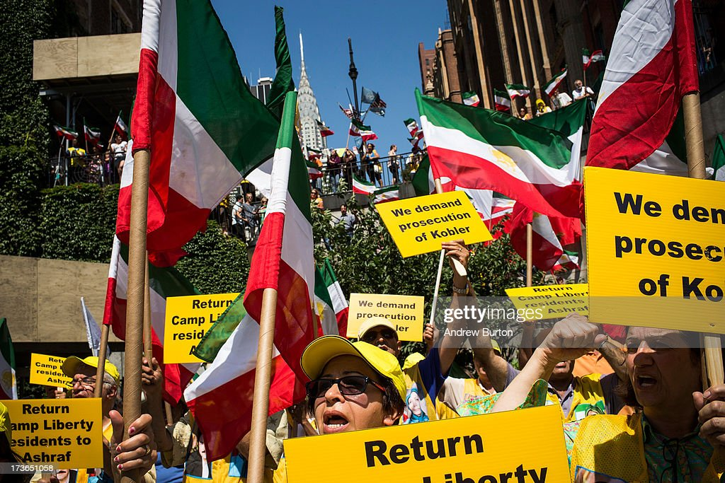 People wave flags during a protest outside the United Nations (U.N.) during a U.N. Security Council meeting on July 16, 2013 in New York City. The protest centered around the recent attacks against exiled Iranian dissidents living in Iraq. Members of The People's Mujahedeen of Iran (MEK) have been living in Camp Ashraf and Camp Camp Liberty, both in Iraq; the protesters allege that the United Nations Assistance Mission in Iraq has not done enough to protect the exiled dissidents from the recent attacks.