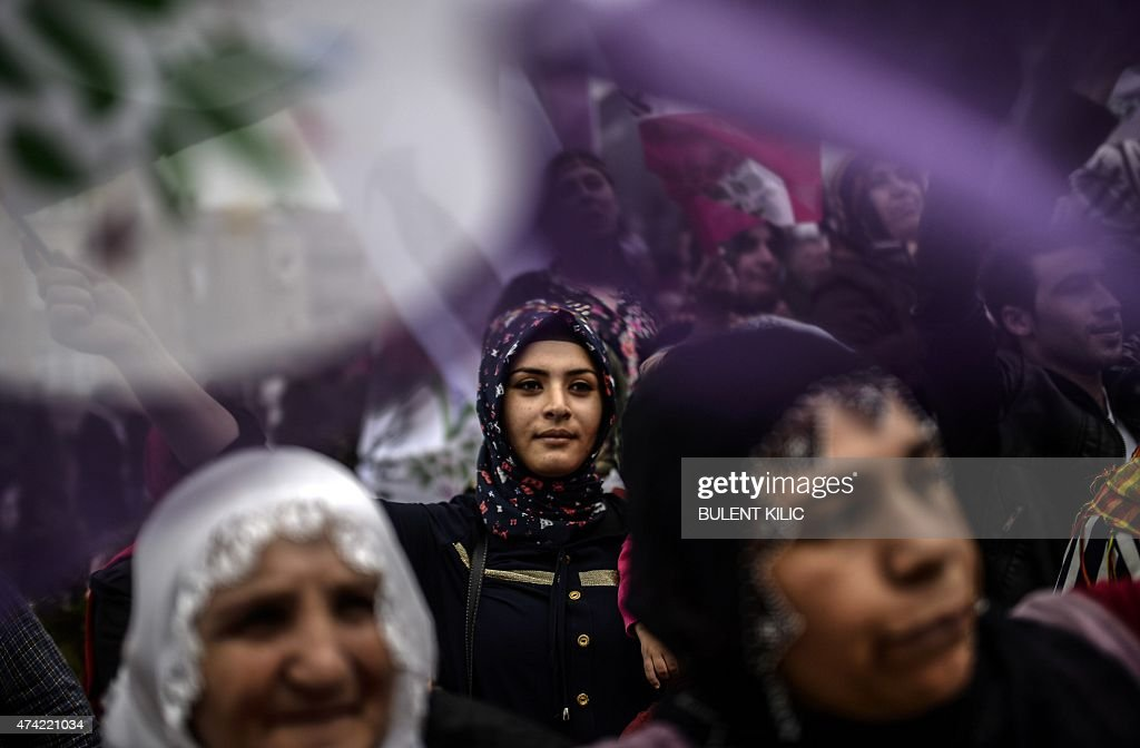 People wave flags in the district of Umraniye in Istanbul on May 21 2015 during an election rally of the leader of the proKurdish Peoples' Democratic...