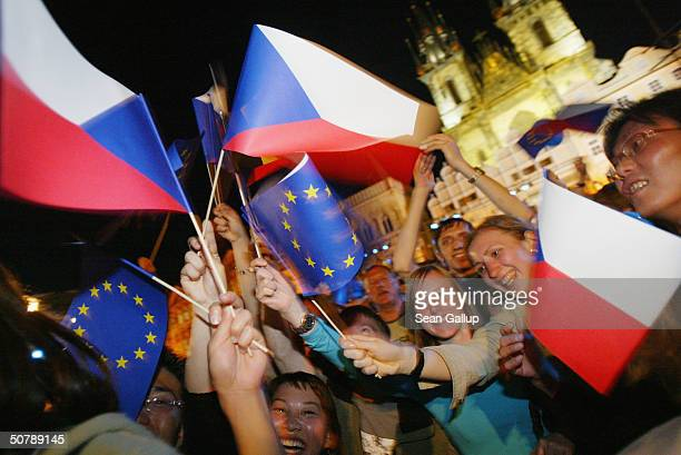 People wave flags of the Czech Republic and the European Union April 30 2004 while celebrating the country's accession to the European Union in...