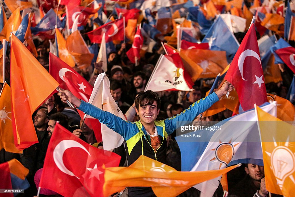 People wave flags outside the ruling AK Party headquarters on November 1, 2015, in Ankara, Turkey. Polls have opened in Turkey's second general election this year, with the ruling Justice and Development Party (AKP) hoping to win a majority, as the country searches for stability amongst serious security concerns.