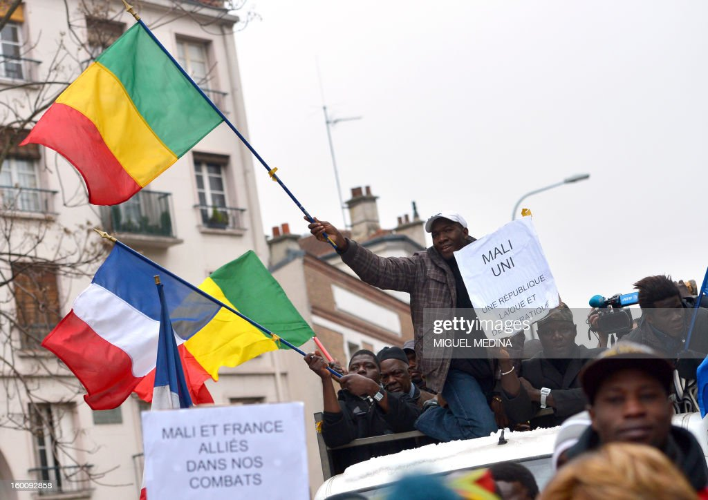 People wave Malian and French flags as they take part to a demonstration, organized by Malian associations, in support of the liberation forces of Mali on January 26, 2013 in Montreuil, near Paris.