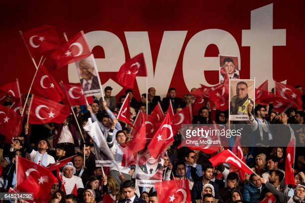 People wave national flags and 'Yes' banners during a rally officially opening the AKP Party 'Yes' constitutional referendum campaign held at the...