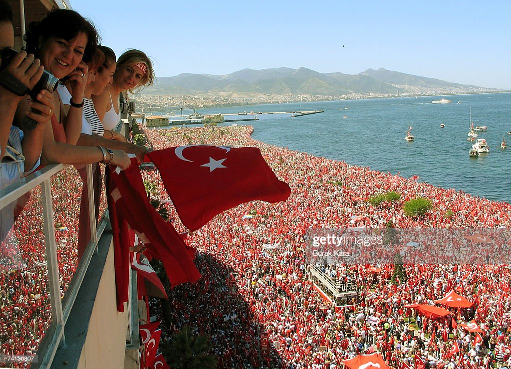 People wave national flags as they fill the waterfront during an anti-government rally on May 13, 2007 in Turkey's western coastal city of Izmir. Thousands of secular Turks gathered in the city of Izmir on Sunday to protest against the Islamist-rooted government in a rally organisers hope will unite the opposition ahead of elections in July.