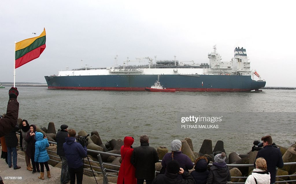 People wave national flags as they welcome the first liquefied natural gas terminal 'Independence' in the port of Klaipeda on October 27 2014 The...