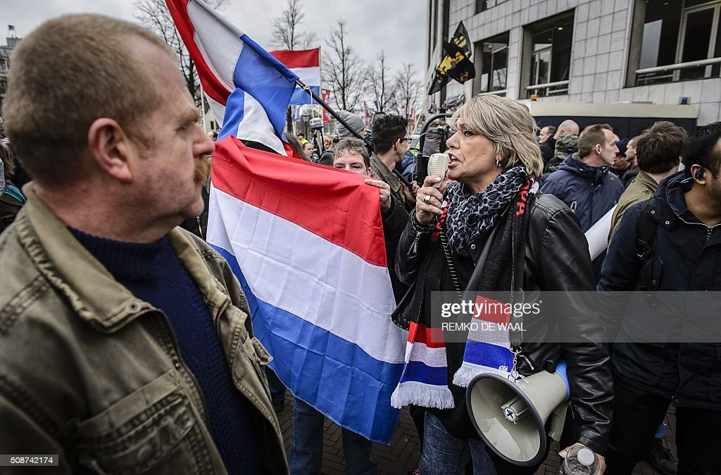 People wave national flags of the Netherlands as members of Pegida (Patriotic Europeans Against the Islamisation of the Occident) protest in central Amsterdam on February 6, 2016. Anti-Islamic group Pegida, which began as a movement in Germany in mid-2014 and has since spread to France and other European countries, has called on members and sympathisers across Europe to join marches on February 6. / AFP / ANP / Remko de Waal / Netherlands OUT