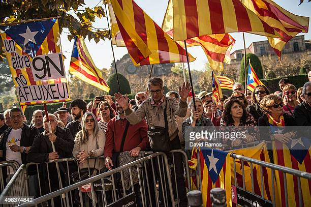 People wave ProIndependence flags as they gather outside the Parliament of Catalonia during a parliamentary session to pass the start of the...
