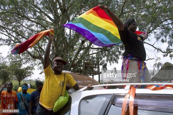 People wave rainbow flag during the the first gay pride rally since the overturning of a tough antihomosexuality law which authorities have appealed...