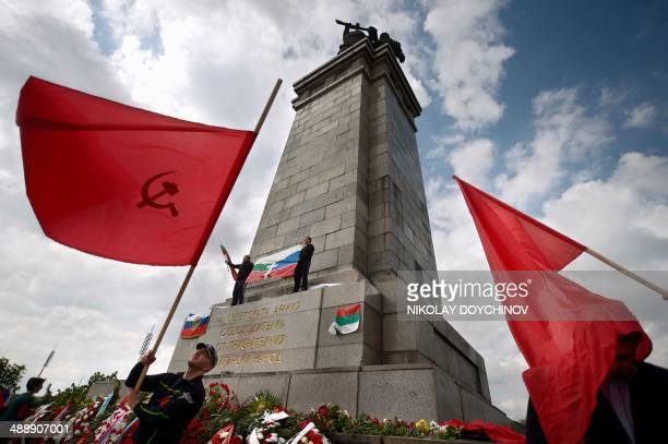 People wave Soviet Union's red flags on May 9 2014 in Sofia during a ceremony marking the 69th anniversary of the Soviet victory in World War II AFP...