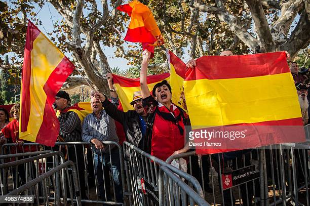 People wave Spanish flags as they protest outside the Parliament of Catalonia during a parliamentary session to pass the start of the independence...