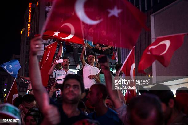 People wave Turkish flags at a rally on the streets of Kizilay Square in reaction to the failed military coup on July 17 2016 in Ankara Turkey Clean...