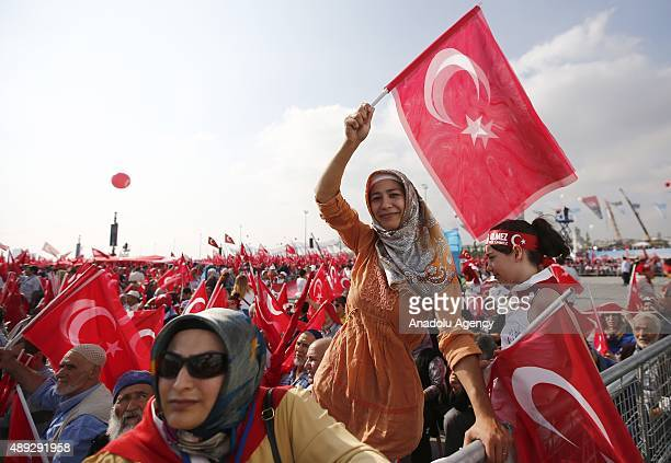 People wave Turkish flags during an antiterror rally at Yenikapi area in Istanbul Turkey on September 20 2015