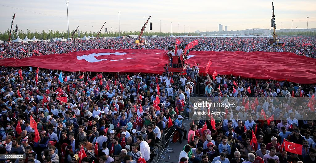 People wave Turkish Flags during the celebrations of the 563rd anniversary of Istanbuls conquest by Turks at Yenikapi Event Area in Istanbul, Turkey on May 29, 2016. On May 29, 1453, Ottoman Sultan Mehmed II (Mehmet the Conqueror) conquered Istanbul, then called Constantinople, from where the Byzantines had ruled the Eastern Roman Empire for more than 1,000 years. The conquest transformed the city, once the heart of the Byzantine realm, into the capital of the new Ottoman Empire.
