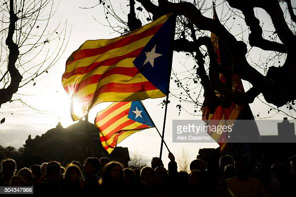 People waves proIndependence of Catalonia flags outside of the Parliament of Catalonia before the parliamentary session debating on electing Carles...