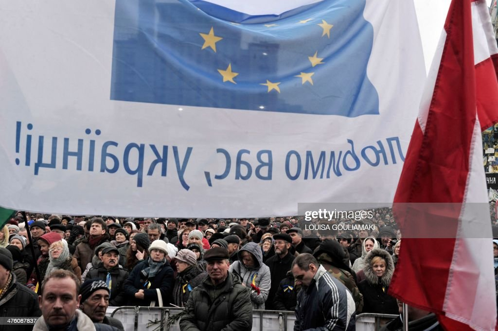 People, waving a flag of the European Union with the inscription 'You like Ukraine!' attend a rally to protest Russia's stance in the Ukraine crisis, on Kiev's Independence square on March 2, 2014. Ukraine is to call up all military reservists, the head of the national security and defence council said on March 2, 2014, after Russia's parliament approved the deployment of troops in the country.