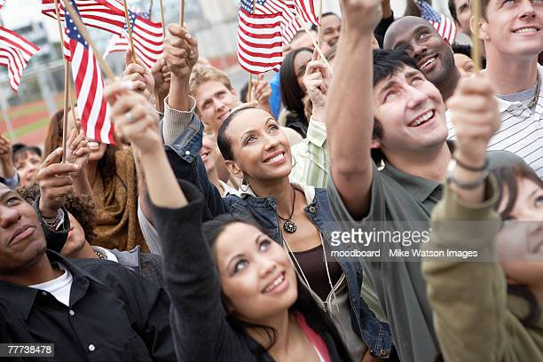 People Waving American Flags