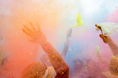 People waving at the festival of colors