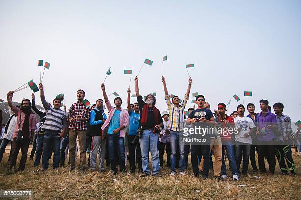 People waving Bangladesh's national flag during a rally to mark the country's Victory Day in Dhaka on December 16 2015 Bangladesh won independence...