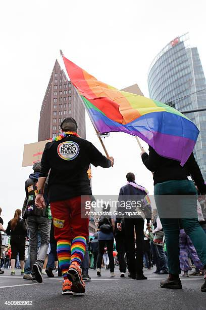 People waving rainbow flags at Berlin's annual Christopher Street Day parade on June 21 2014 in Berlin Germany Gays and lesbians all around the world...