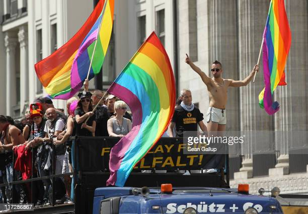 People waving rainbow flags participate in the annual Christopher Street Day Parade on June 25 2011 in Berlin Germany The parade celebrates gays...