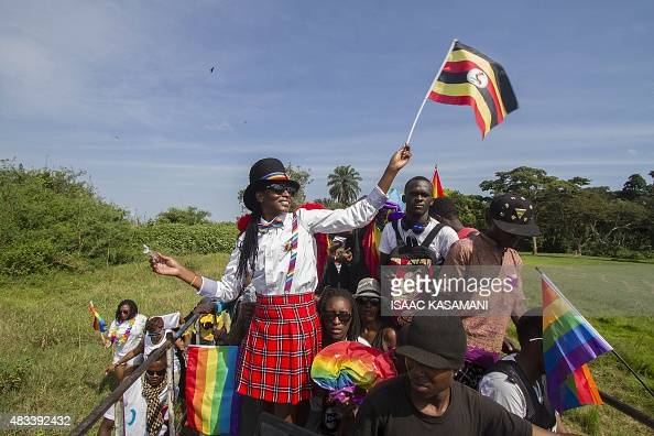 People waving Ugandan and rainbow flags take part in the Gay Pride parade in Entebbe on August 8 2015 Ugandan activists gathered for a gay pride...
