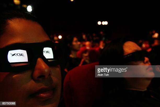 People wear 3D glasses at the 3DX Film Festival at Golden Village on November 18 2008 in Singapore 3DX is the world's first fully 3D based film and...