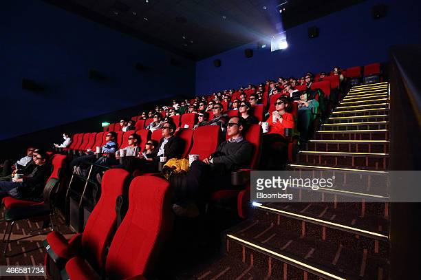 People wear 3D glasses while watch a movie in the Wanda Cinema Line Co cinema at the Tongzhou Wanda Plaza shopping mall operated by Dalian Wanda...
