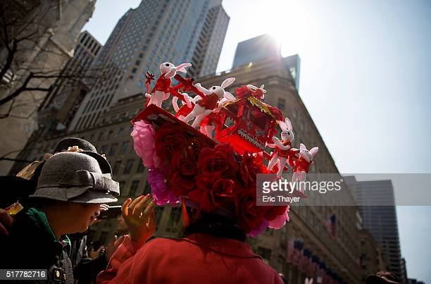 People wear bonnets during the Easter Parade and Bonnet Festival along 5th Avenue March 27 2016 in New York City The parade is a New York tradition...