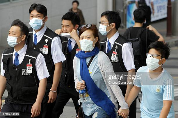 People wear masks as a precaution against the MERS virus on June 2 2015 in Seoul South Korea The Ministry of Health and Welfare of South Korea...