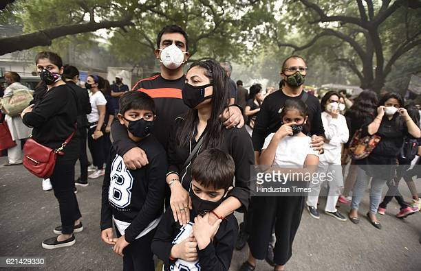 People wear pollution masks during the protest march for 'Your Right To Breathe' at Jantar Mantar on November 6 2016 in New Delhi India New Delhi's...