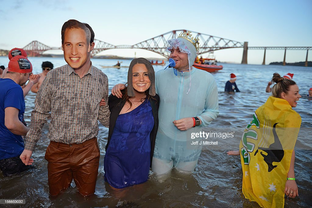 People wear Prince William, Duke of Cambridge and Catherine, Duchess of Cambridge masks as they joined over 1,000 New Year swimmers, many in costume, braved freezing conditions in the River Forth in front of the Forth Rail Bridge during the annual Loony Dook Swim on January 1, 2013 in South Queensferry, Scotland. Thousands of people gathered last night to see in the New Year at Hogmanay celebrations in towns and cities across Scotland.