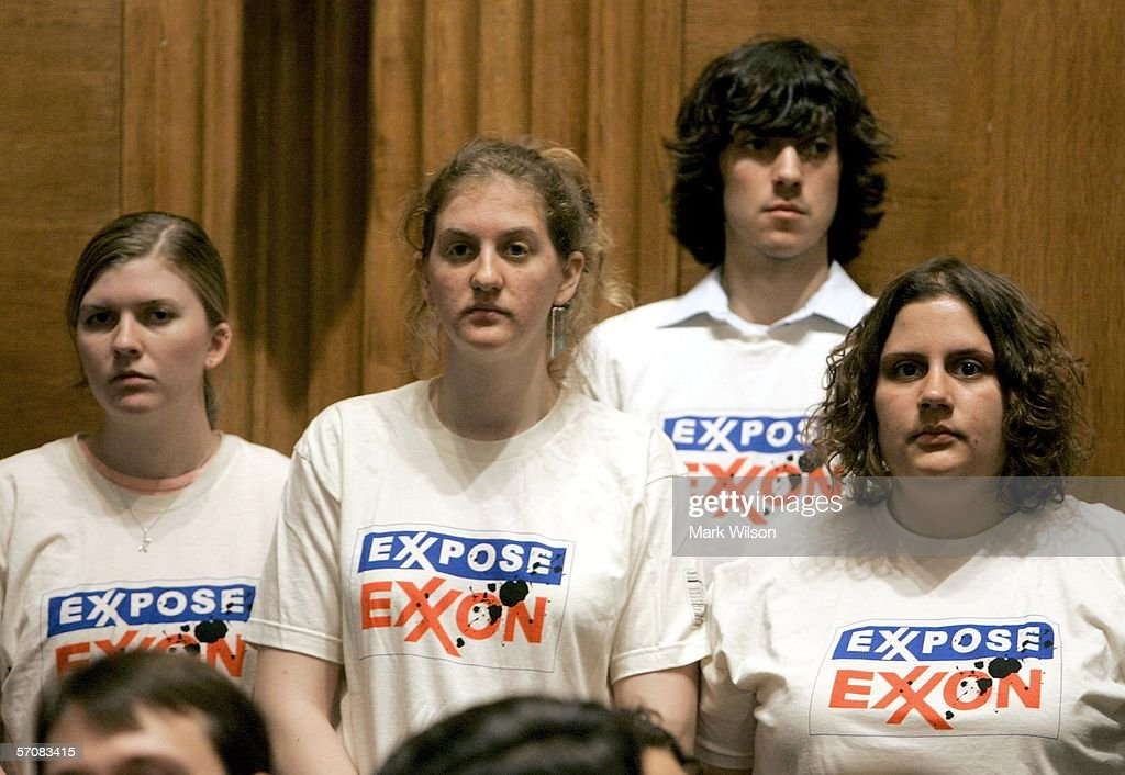 People wear shirts that read 'Exxpose Exxon' during a Senate Judiciary Committee hearing on Capitol Hill March 14, 2006 in Washington, DC. Energy executives were testifying before the committee on consolidation in the oil and gas industry and rising fuel prices.