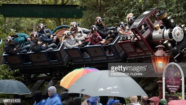 People wear virtual reality glasses in a roller coaster during the presentation of Europa Park's new attraction in Rust BadenWürttemberg on September...