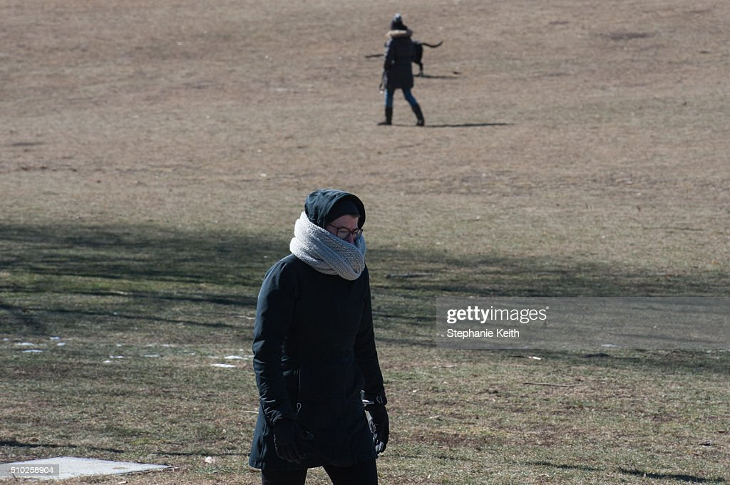 People wear warm winter clothes as they walk in Prospect Park during an arctic chill that brought frigid temperatures on February 14, 2016 in the Brooklyn borough of New York City.