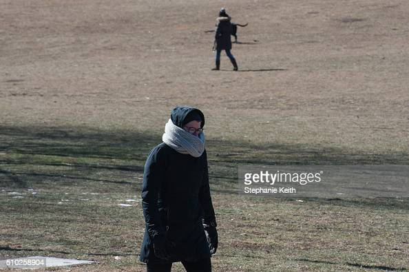 People wear warm winter clothes as they walk in Prospect Park during an arctic chill that brought frigid temperatures on February 14 2016 in the...