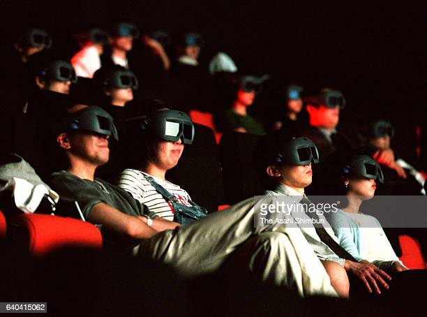 People wearing 3D glasses enjoy a cinema at the IMAX Theatre in the Takashimaya Times Square on June 4 1999 in Tokyo Japan