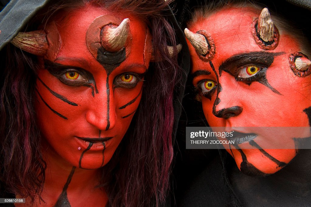 People wearing a Dark Maul costume takes part in a Star Wars convention in Cusset, on May 1, 2016. / AFP / Thierry Zoccolan