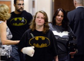 People wearing Batman shirts arrive at the Arapahoe County Courthouse for the arraignment of accused theater gunman James Holmes July 30 2012 in...