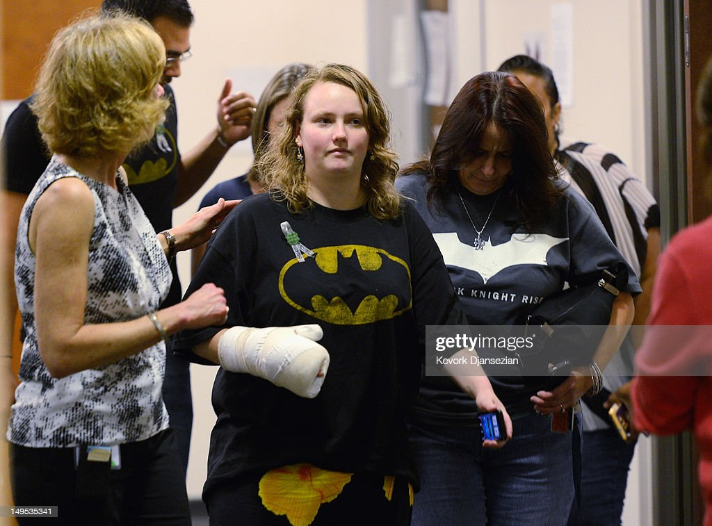 People wearing Batman shirts arrive at the Arapahoe County Courthouse for the arraignment of accused theater gunman James Holmes July 30, 2012 in Centennial, Colorado. Holmes is charged with 24 counts of murder and 116 counts of attempted murder in the July 20, shooting rampage at an opening night screening of 'The Dark Knight Rises' in Aurora, Colorado.