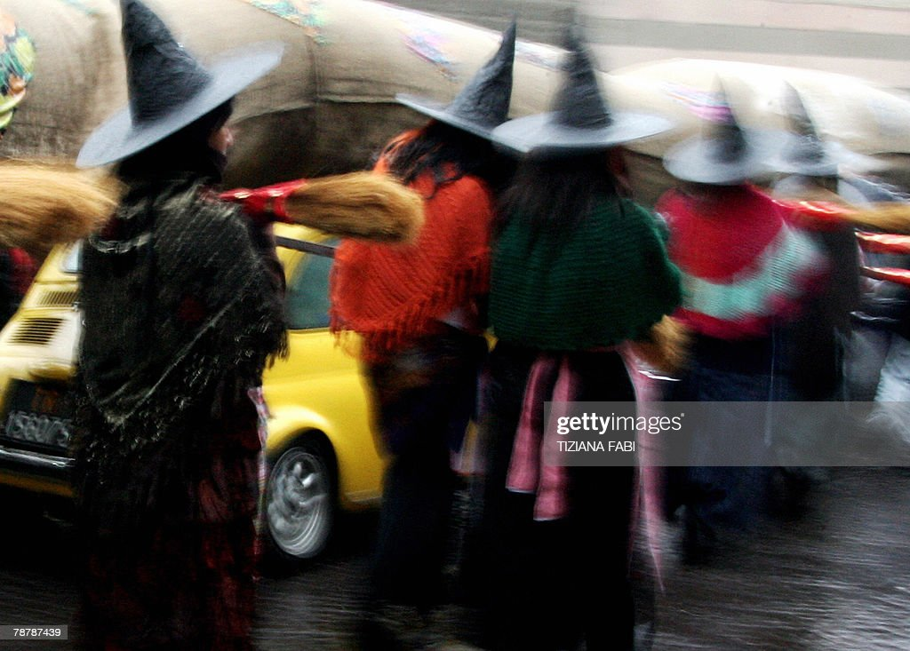 People wearing Befana outfits take part to the annual Befana parade in Viterbo 05 January 2008 on Epiphany Eve In Italy Epiphany is celebrated with...