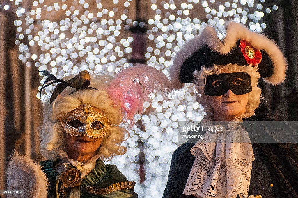 People wearing carnival costumes pose in Piazza San Marco during the 2016 Venice Carnival on February 9, 2016 in Venice, Italy. The 2016 Carnival of Venice will run until February 9 and includes a program of gala dinners, parades, dances, masked balls and music events.