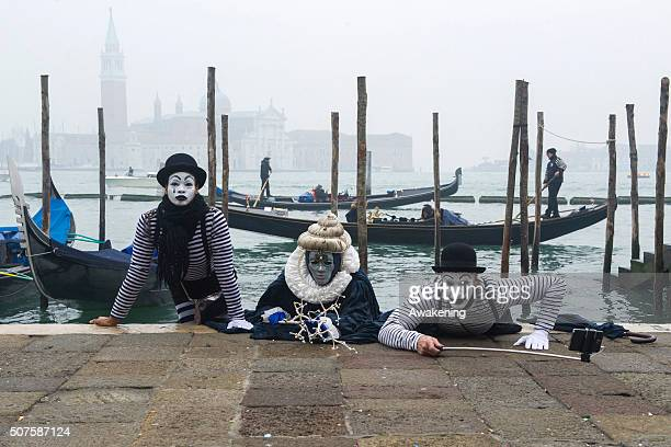 People wearing carnival dress pose in St Mark square during the 2016 Venice Carnival on January 30 2016 in Venice Italy The 2016 Carnival of Venice...