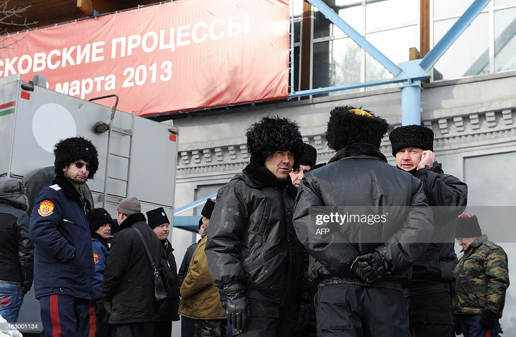 People wearing Cossack uniforms gather in front of Sakharov Centre in protest against the play 'The Moscow Trials' being performed in Moscow, on March 3, 2013. Russian migration officials disrupted a Moscow play at the Sakharov Centre by a Swiss director Milo Rau about the trial against punk band Pussy Riot trial, while religious activists caused a commotion outside. The political play The Moscow Trials staged by director Milo Rau reenacted last year's trial against Pussy Riot members, with many of the actual participants, including member Yekaterina Samutsevich, taking part.