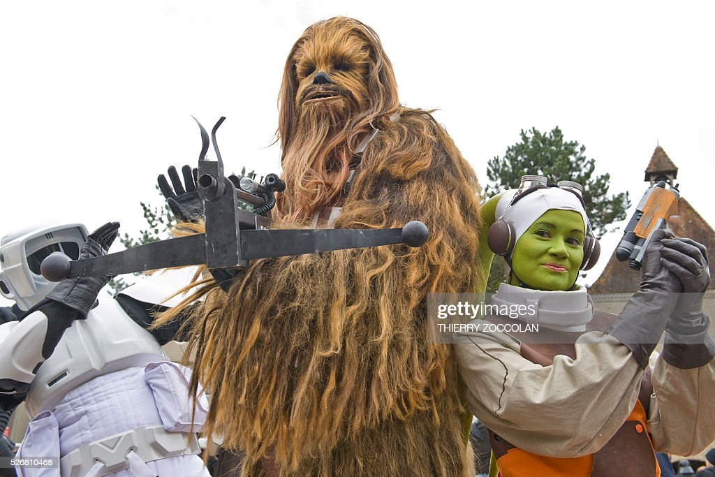 People wearing costumes take part in a Star Wars convention in Cusset, on May 1, 2016. / AFP / Thierry Zoccolan