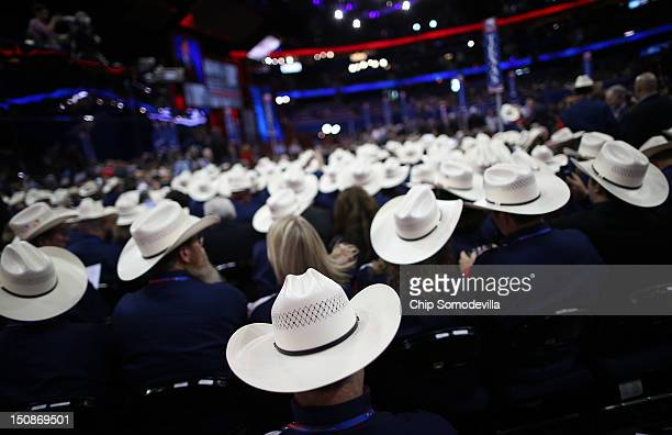 People wearing cowboy hats sit during the Republican National Convention at the Tampa Bay Times Forum on August 28 2012 in Tampa Florida Today is the...