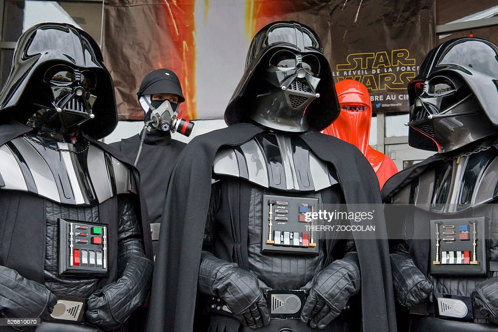 People wearing Dark Vader costumes take part in a Star Wars convention in Cusset, on May 1, 2016. / AFP / Thierry Zoccolan